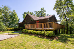 Sunny view of looking glass realty's vacation rental Mountain View Cabin
